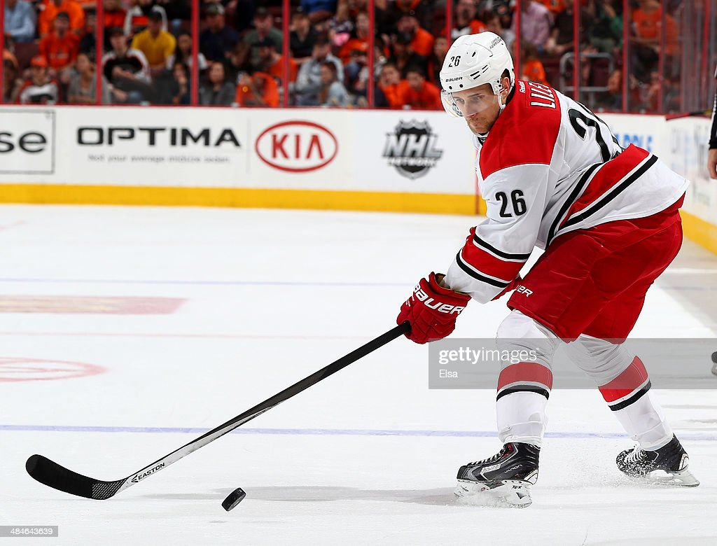 John-Michael Liles #26 of the Carolina Hurricanes takes the puck in the third period against the Philadelphia Flyers at Wells Fargo Center on April 13, 2014 in Philadelphia, Pennsylvania.The Carolina Hurricanes defeated the Philadelphia Flyers 6-5 in an overtime shootout.