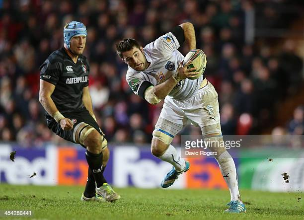Johnnie Beattie of Montpellier moves away with the ball as Jordan Crane looks on during the Heineken Cup match between Leicester Tigers and...