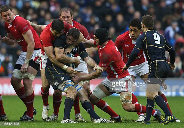 Johnnie Beattie of Scotland is stoppped by the Welsh defence during the RBS Six Nations match between Scotland and Wales at Murrayfield Stadium on...