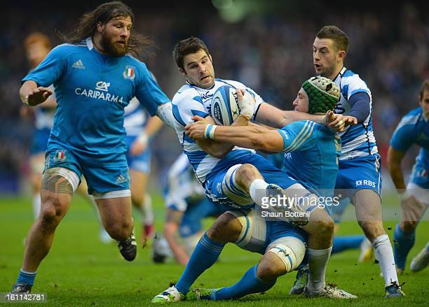 Johnnie Beattie of Scotland is tackled by Francesco Minto of Italy during the RBS Six Nations match between Scotland and Italy at Murrayfield Stadium...