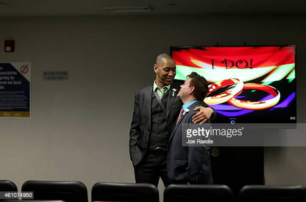 Johnnie Bowls embraces Will Hill before being married during a ceremony at the Broward County Courthouse on January 6 2015 in Fort Lauderdale Florida...