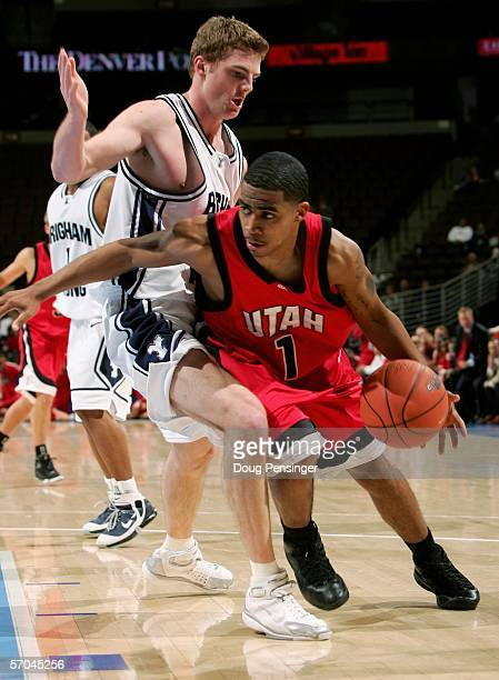 Johnnie Bryant of the Utah Runnin' Utes drives around Jimmy Balderson of the Brigham Young University Cougars during the Mountain West Conference...