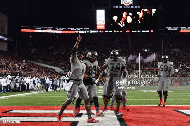 Johnnie Dixon of the Ohio State Buckeyes celebrates after catching a 10-yard touchdown pass in the fourth quarter against the Penn State Nittany...
