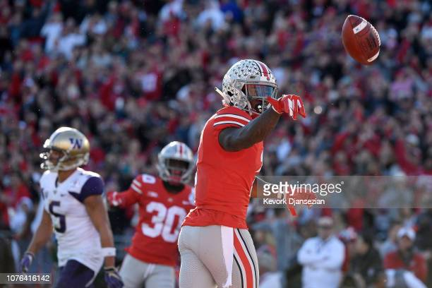 Johnnie Dixon of the Ohio State Buckeyes celebrates after scoring a 19yard touchdown during the first half in the Rose Bowl Game presented by...