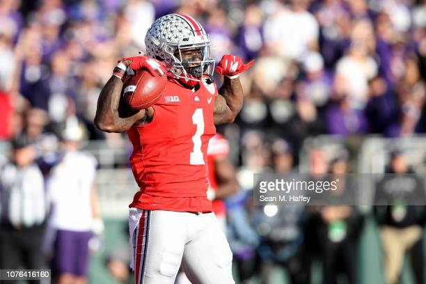 Johnnie Dixon of the Ohio State Buckeyes celebrates after scoring a touchdown during the first half in the Rose Bowl Game presented by Northwestern...