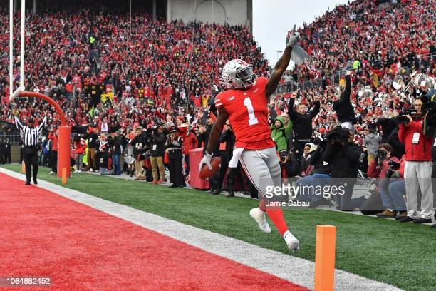 Johnnie Dixon of the Ohio State Buckeyes celebrates in the end zone after catching a 31yard touchdown pass in the second quarter against the Michigan...