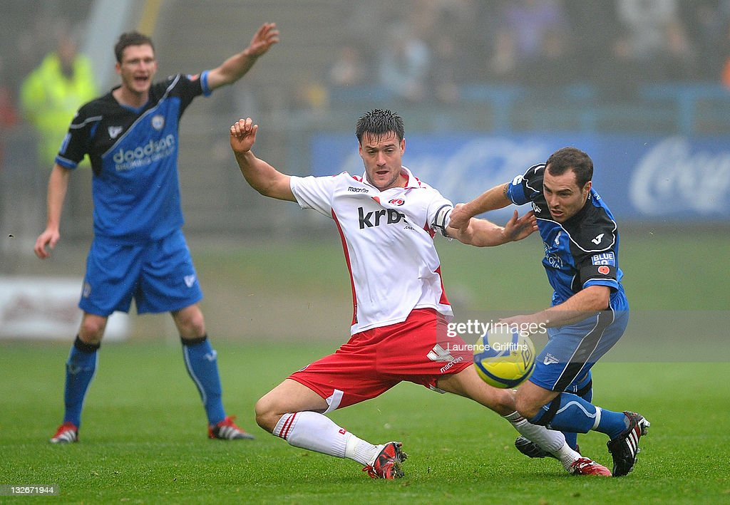 Johnnie Jackson of Charlton battles with Tom Baker of Halifax Town (R) during the FA Cup sponsored by Budweiser First Round match between Halifax Town and Charlton Athletic at the Shay on November 13, 2011 in Halifax, England.
