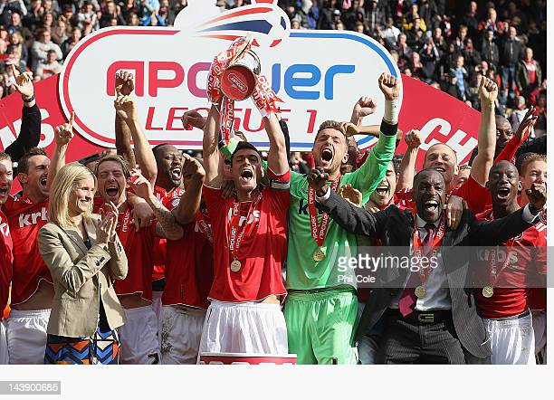 Johnnie Jackson of Charlton lifts the Trophy after winning npower League One after the match between Charlton Athletic and Hartlepool United at The...