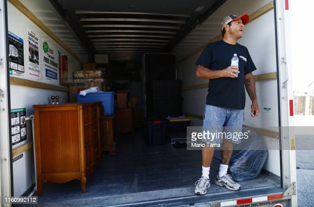 Johnnie Jackson stands in a UHaul truck with items removed from the Eldridge family home which has been deemed uninhabitable due to structural damage...