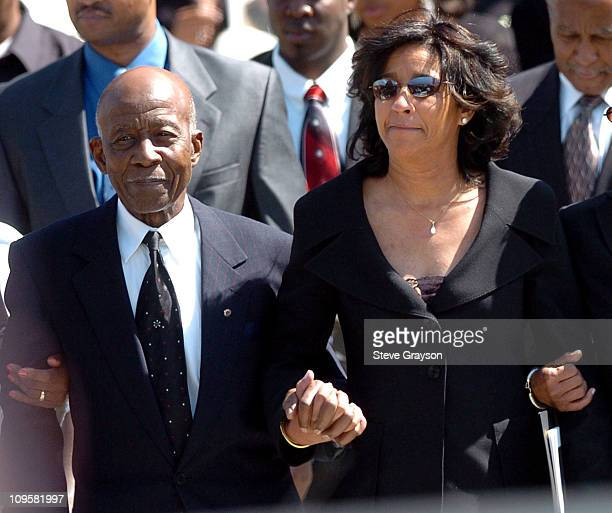 Johnnie L Cochran Sr father and Dale Cochran wife of the late Johnnie Cochran leave the West Angeles Cathedral where the funeral service for Johnnie...