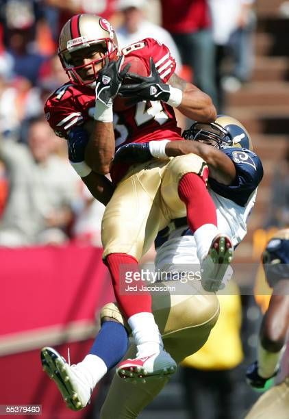 Johnnie Morton of the San Francisco 49ers makes a reception against DeJuan Groce of the St Louis Rams during the NFL game at Monster Park on...