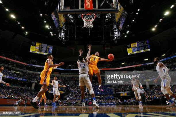 Johnnie Vassar of the Tennessee Tech Golden Eagles drives to the basket for a layup against Victor Enoh of the Memphis Tigers on November 6, 2018 at...