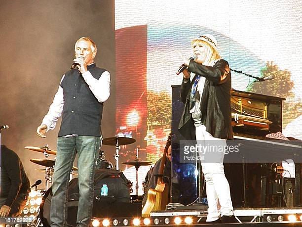 Johnnie Walker and Sally Boazman introduce artistes on stage at the BBC Radio 2 Festival In A Day concert at Hyde Park on September 8, 2013 in...