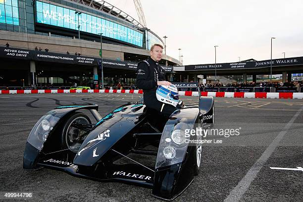 Johnnie Walker Global Responsible Drinking Ambassador Mika Hakkinen poses for photographs sitting on the Caparo T1 outside Wembley Stadium on...
