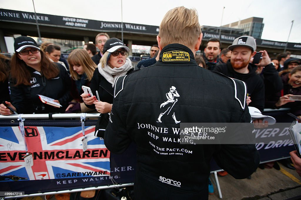 Johnnie Walker® Global Responsible Drinking Ambassador Mika Häkkinen meets the fans outside Wembley Stadium on December 4, 2015 in London, England. The former F1 driver was in London for the launch of the Johnnie Walker® festive responsible drinking initiative Join The Pact, to encourage people to make the pledge to never drink and drive. As part of the campaign, the Scotch whisky brand has pledged to give away 450,000 kilometres of safe rides home around the world this festive season. In addition, this year and starting in London, some people will have the opportunity to go one step further and experience the joy of festive giving by nominating a friend for a safe ride home. Join The Pact by visiting jointhepact.com or by tweeting #JoinThePact to @JohnnieWalker_.