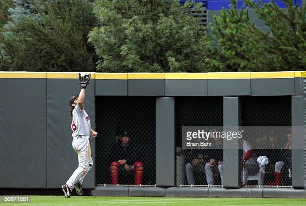 Johnnny Damon of the Boston Red Sox catches a fly ball to deep centerfield by Aaron Miles of the Colorado Rockies in the eighth inning on June 17...