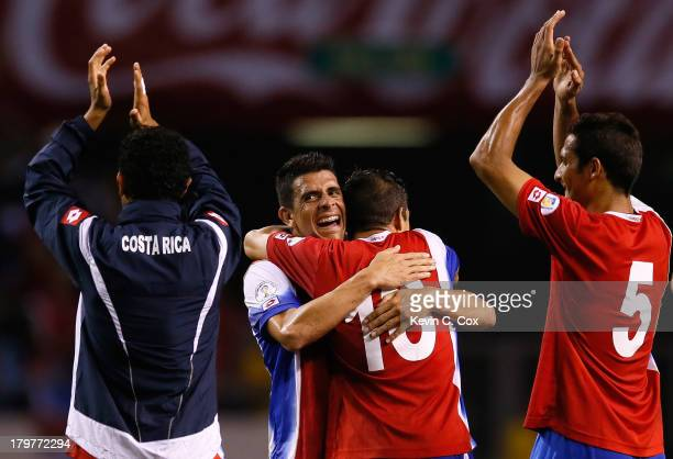 Johnny Acosta and Christian Gamboa celebrate their 3-1 win over the United States during the FIFA 2014 World Cup Qualifier at Estadio Nacional on...