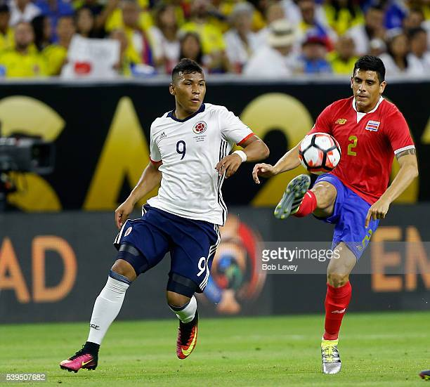 Johnny Acosta Of Costa Rica Controls The Ball As He His Defended By Roger Martinez