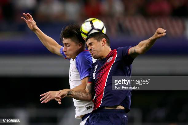 Johnny Acosta of Costa Rica heads the ball against Kelyn Rowe of United States during the 2017 CONCACAF Gold Cup Semifinal at ATT Stadium on July 22...