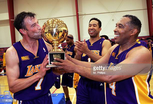 Johnny Alves of the Los Angeles Lakers and his teammates celebrate the win over the Atlanta Hawks at Crossroads High School in Santa Monica...