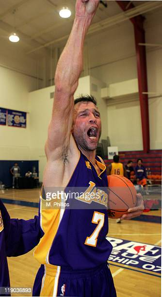 Johnny Alves of the Los Angeles Lakers celebrates the win over the Atlanta Hawks at Crossroads High School in Santa Monica California The Los Angeles...