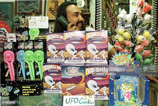 Johnny Amador a Roswell New Mexico store owner talks on the phone as he sells UFO souvenirs 01 July Roswell residents are preparing for the 50th...