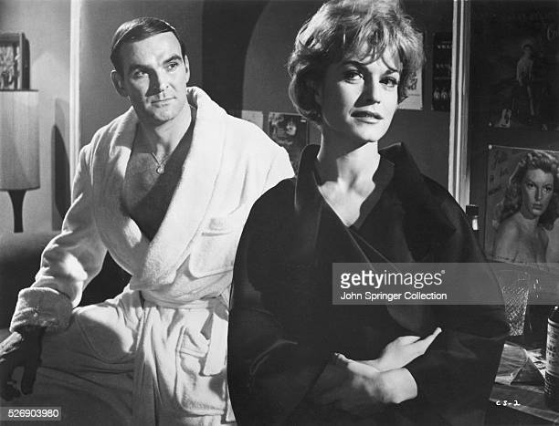 Johnny Bannion and Suzanne don bathrobes in a scene from the 1960 film The Criminal