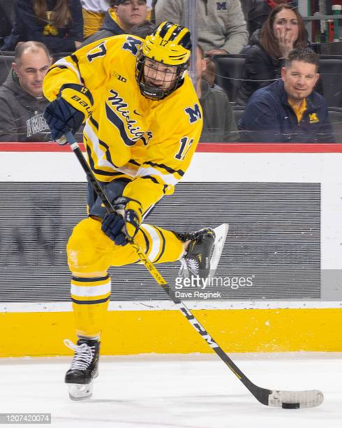 Johnny Beecher of the Michigan Wolverines shoots the puck against the Michigan State Spartans during the first period of the annual NCAA hockey game,...