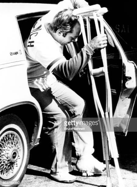 Johnny Bench of the Cincinnati Reds gets into the backseat of a car as he leaves Christ Hospital with a cast on his left ankle after breaking it...