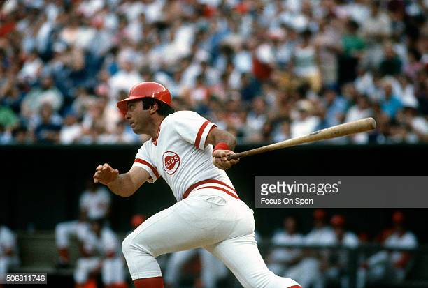 Johnny Bench of the Cincinnati Reds swings and watches the flight of his ball during an Major League Baseball game circa 1975 at Riverfront Stadium...