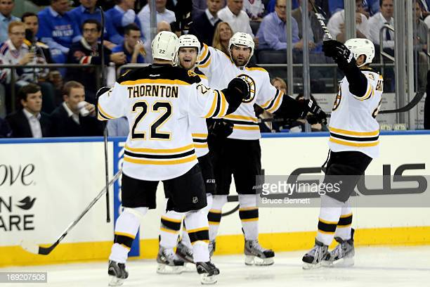 Johnny Boychuk of the Boston Bruins celebrates with teammates Shawn Thornton Daniel Paille and Matt Bartkowski after scoring a goal in the third...