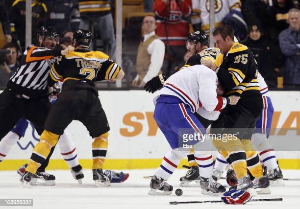 Johnny Boychuk of the Boston Bruins fights with Jaroslav Spacek of the Montreal Canadiens is Shawn Thornton of the Bruins and Brian Gionta of the...