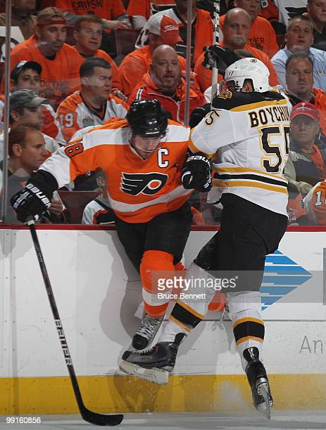 Johnny Boychuk of the Boston Bruins hits Mike Richards of the Philadelphia Flyers in Game Six of the Eastern Conference Semifinals during the 2010...