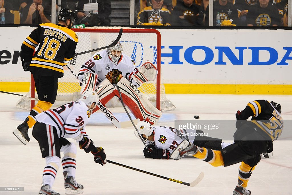 Johnny Boychuk #55 of the Boston Bruins shoots the puck and scores a goal against the Chicago Blackhawks in Game Four of the Stanley Cup Final at TD Garden on June 19, 2013 in Boston, Massachusetts.