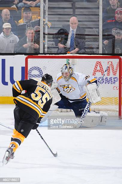 Johnny Boychuk of the Boston Bruins shoots the puck to score a goal against Marek Mazanec of the Nashville Predators at the TD Garden on January 2...