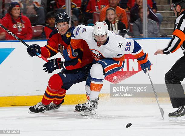 Johnny Boychuk of the New York Islanders and Nick Bjugstad of the Florida Panthers battle for control of the puck in Game Five of the Eastern...