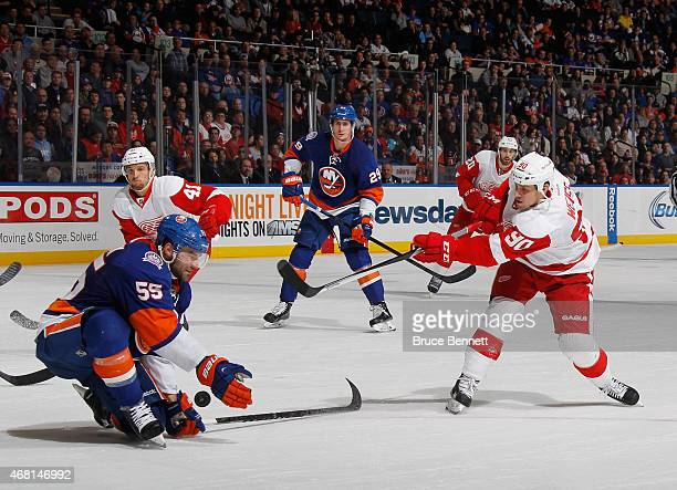 Johnny Boychuk of the New York Islanders blocks a shot by Stephen Weiss of the Detroit Red Wings at the Nassau Veterans Memorial Coliseum on March 29...