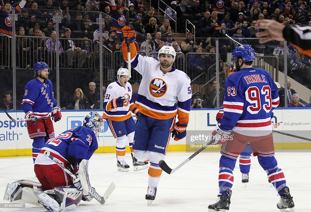 Johnny Boychuk #55 of the New York Islanders celebrates his goal at 2:50 of the first period against Antti Raanta #32 of the New York Rangers at Madison Square Garden on March 6, 2016 in New York City.