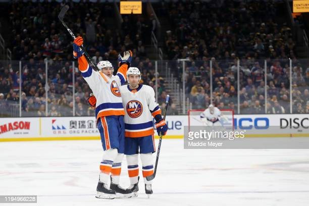 Johnny Boychuk of the New York Islanders celebrates with Jordan Eberle after scoring a goal against the Boston Bruins during the second period at TD...