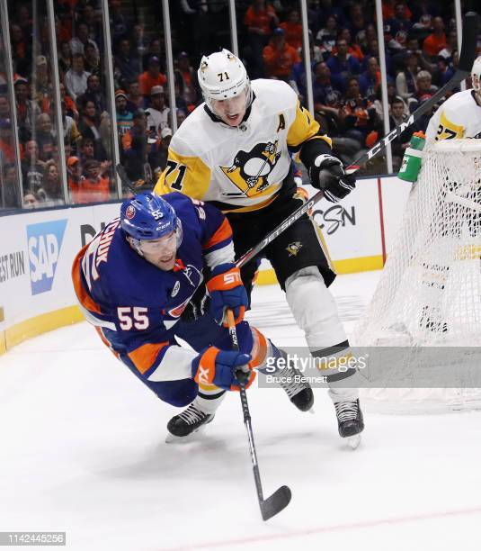 Johnny Boychuk of the New York Islanders checks Evgeni Malkin of the Pittsburgh Penguins in Game Two of the Eastern Conference First Round during the...