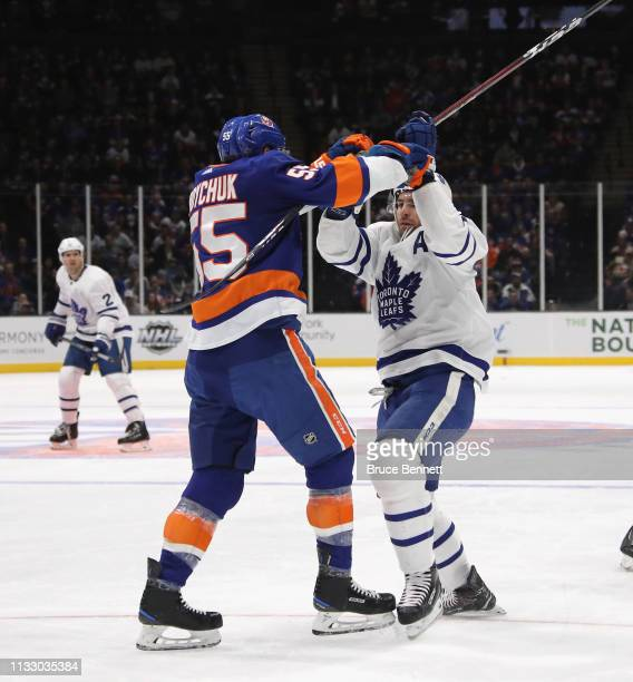 Johnny Boychuk of the New York Islanders checks John Tavares of the Toronto Maple Leafs at NYCB Live's Nassau Coliseum on February 28 2019 in...