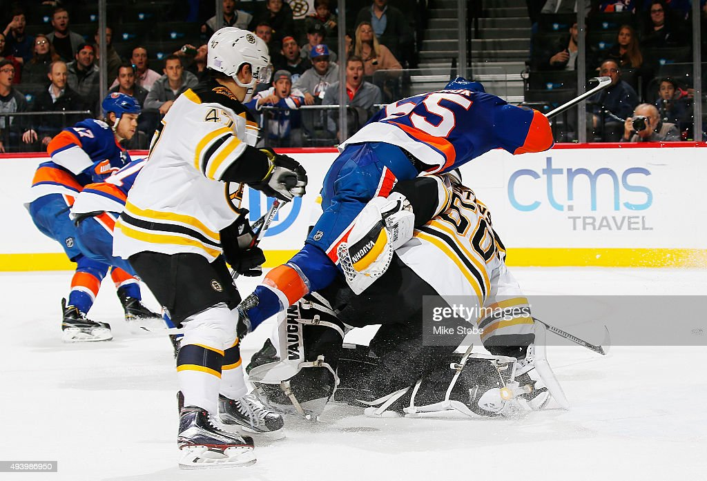 Johnny Boychuk #55 of the New York Islanders collides with Jonas Gustavsson #50 of the Boston Bruins during the game at the Barclays Center on October 23, 2015 in Brooklyn borough of New York City. The Bruins defeated the Islanders 5-3.