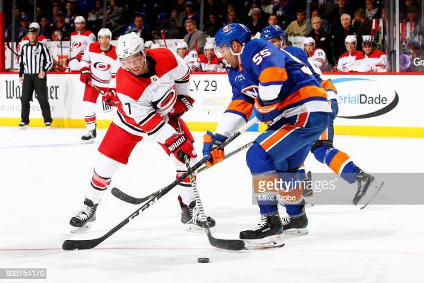 Johnny Boychuk of the New York Islanders defends against Derek Ryan of the Carolina Hurricanes during the second period at Barclays Center on March...