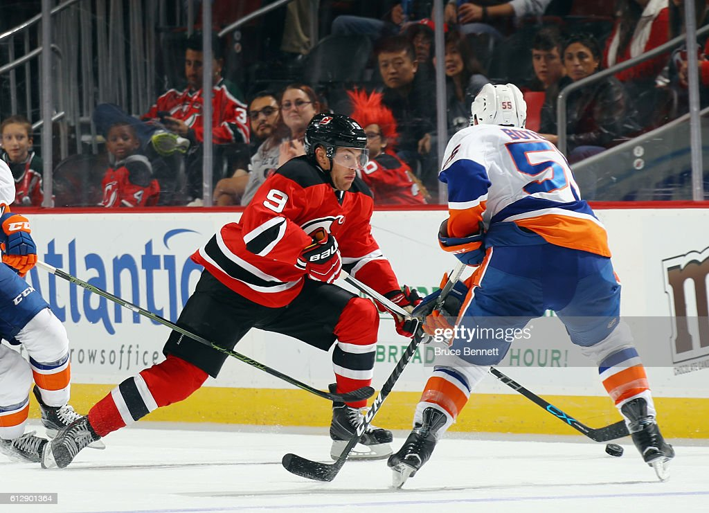 Johnny Boychuk #55 of the New York Islanders defends against Taylor Hall #9 of the New Jersey Devils during the second period at the Prudential Center on October 5, 2016 in Newark, New Jersey.