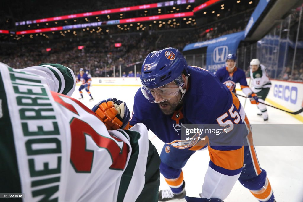 Johnny Boychuk #55 of the New York Islanders fights for the puck against Nino Niederreiter #22 of the Minnesota Wild in the first period during their game at Barclays Center on February 19, 2018 in the Brooklyn borough of New York City.