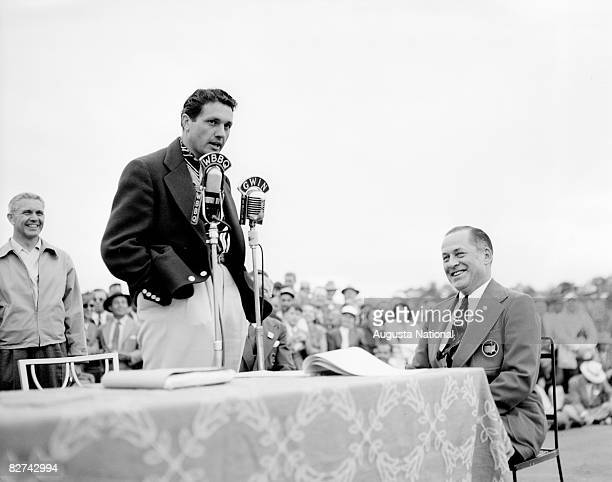 Johnny Bulla speaks as Bobby Jones listens during the Presentation Ceremony after the 1949 Masters Tournament at Augusta National Golf Club on April...