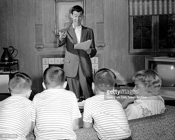 Johnny Carson and his family at his home Birch Hill Estate Winfield Ave Harrison NY Rehearsing TV skit in the dean Johnny gets a hand with script...