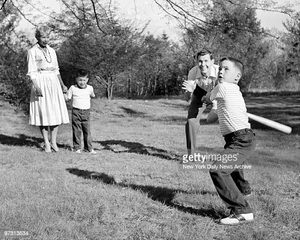 Johnny Carson and his family at his home Birch Hill Estate Winfield Ave Harrison NY Time for baseball Johnny plays some baseball with his sons