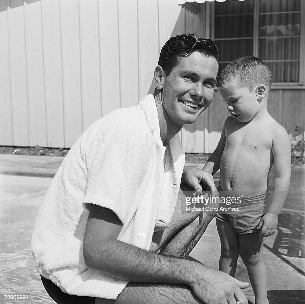 Johnny Carson host of The Johnny Carson Show on CBS and son Cory play their pool on July 5 1956 in Los Angeles California