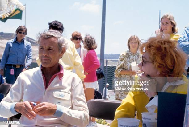 Johnny Carson host of the Tonight Show and Lucille Ball chat at a private Tennis club circa 1975 in Los Angeles California